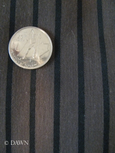 Black and brown pinstripes with a quarter for scale.