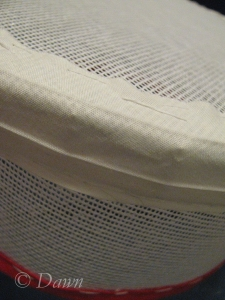 Covering the edge of the pillbox with extra-wide bias tape to soften the seam.