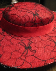 Adding the red grosgrain hat band which covers the stitching