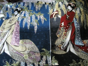 Two colourways of a cotton quilt panel.  The left (blue) panel is from Kimura's while the right (red) panel is from Topstitch.