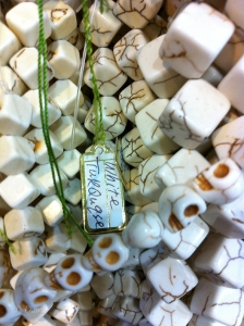 Skull beads among other semi-precious beads (iPhone photo)