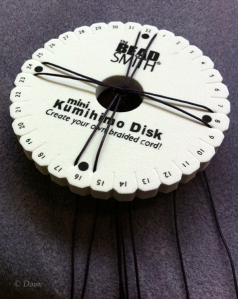 Setting up the disc with the cords secured at four corners and the knot centered in the hole to the back.