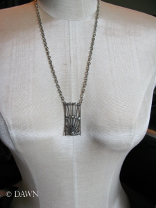 Art Deco-style pendant on a chain
