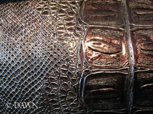 Snakeskin PVC from the grandmother's fabric sale. This will make an amazing bag or corset