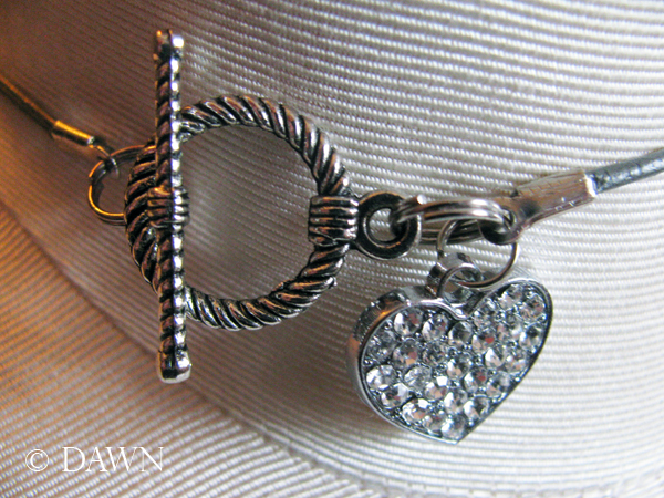 Rhinestone-heart accented tggle clasp on the Super Bling Overload necklace
