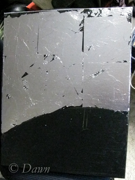Foil applied to the first canvas over the black underpainting