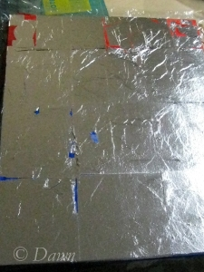 foil applied to the red and blue painted canvas