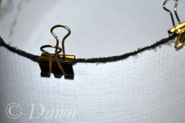 Close up of the binder clips used to 'pin' the Wellington band to the Pillbox band