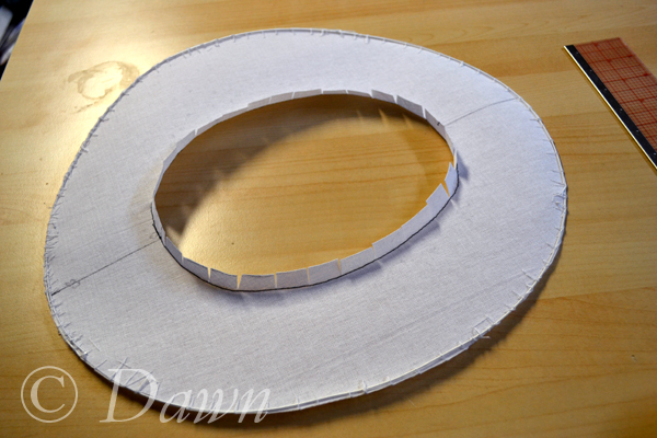 The brim cut out, wired, and with the inner seam allowance clipped and folded upwards