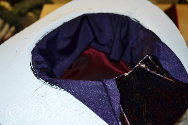Sewing the lining of the hat to the buckram at the brim edge
