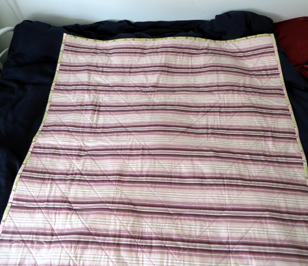 "Modified ""French braid"" quilt back - just a pretty pink, purple and off-white stripe."
