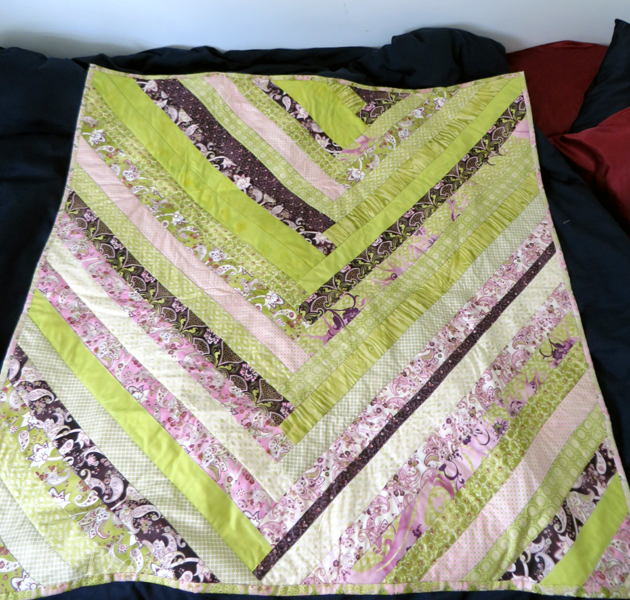 "Modified ""French braid"" quilt top in green, pink, purple and white."