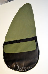 Pocket installed onto the teardrop shaped backpack side panel before adding in the gusset connecting the two halves.