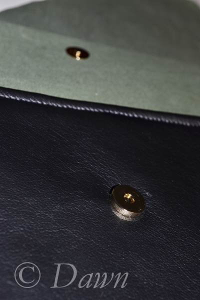 """male"" and ""female"" magnetic snaps on the pocket and pocket flap"