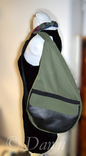 Green and black pleather teardrop shaped hand-made backpack - worn over the shoulder