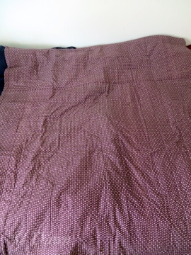 """Backing fabric of the """"Migrating Flying Geese"""" quilt - it's a very small print, so overall it just looks purple."""