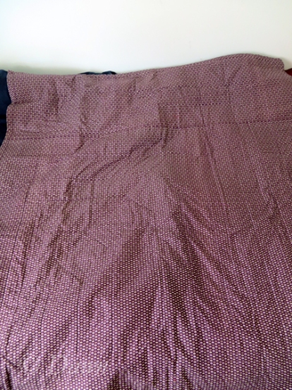 "Backing fabric of the ""Migrating Flying Geese"" quilt - it's a very small print, so overall it just looks purple."