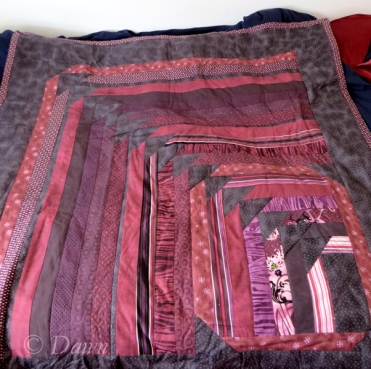 """""""Migrating Flying Geese"""" quilt top in purples, pinks, and greys from the Jelly Roll fabric selection"""