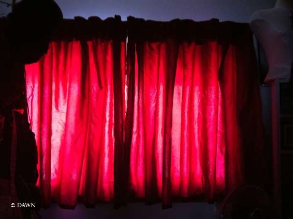 iPhone photo of my glowing red curtains