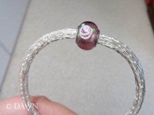 The silver wire chain, once through the smallest drawplate hole, is small enough for a Pandora-style glass bead!