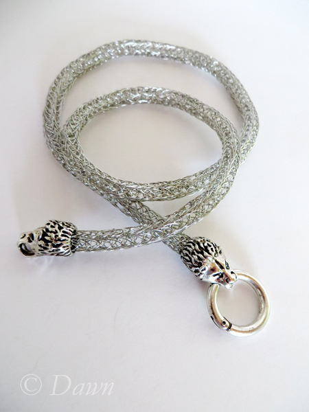 Stainless steel Viking Knit necklace with lion-head end caps and a spring gate clasp.