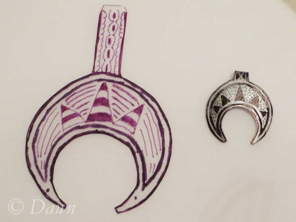 Lunula pendant before and after shrinking