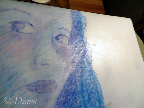 self-portrait in pencil crayon on shrink plastic before shrinking