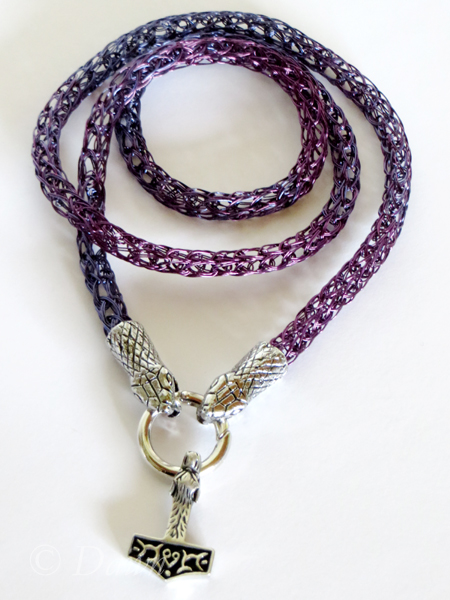 Blended two-colour Viking Knit necklace with snake-head terminals, a circular spring-gate clasp, and a hammer of Thor wolf-head pendant.