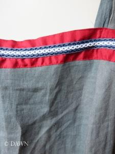 Trim on the blue apron dres