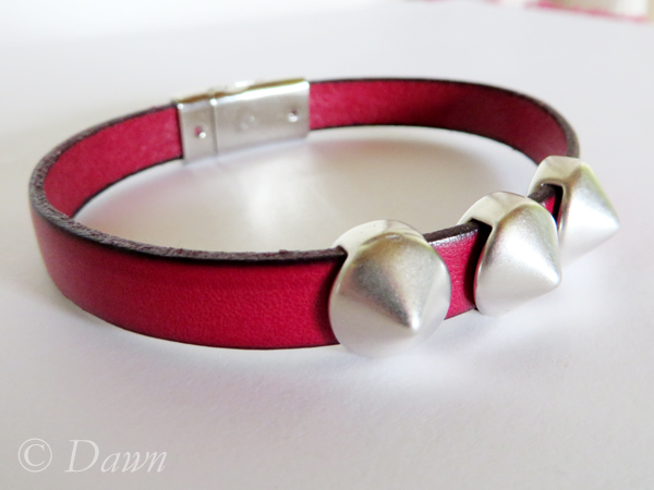 Red flat Greek leather cuff with pyramid studs and a magnetic clasp