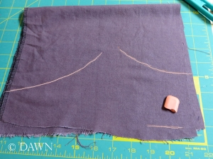 I just drew the shape of the yoke on the fabric with chalk... and hoped for the best!