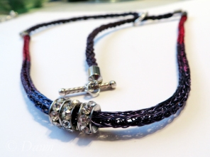 Necklace made with three-colour Viking Knit cord and cotton Kumihimo cord (accented by three rhinestone rhondelles)