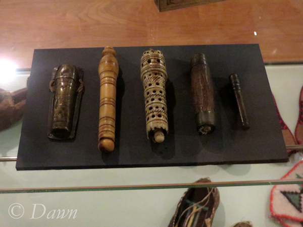 Needle cases, displayed alongside tablet weaving