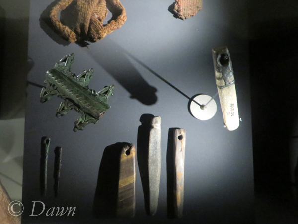 Needle case, needles, and textile fragments
