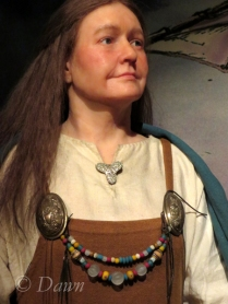 Tri-lobed brooch on the figure at the Saga Museum