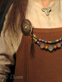 Tortoise brooches on the figure representing one of the first women settlers in Iceland