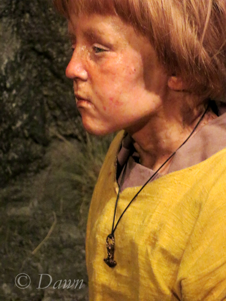 child figure at the Saga museum wearing a Thor's hammer necklace