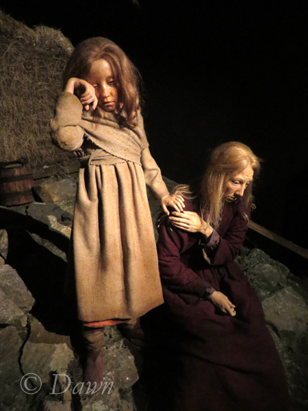 A figure of an Icelandic woman and her child crying over the death of her husband