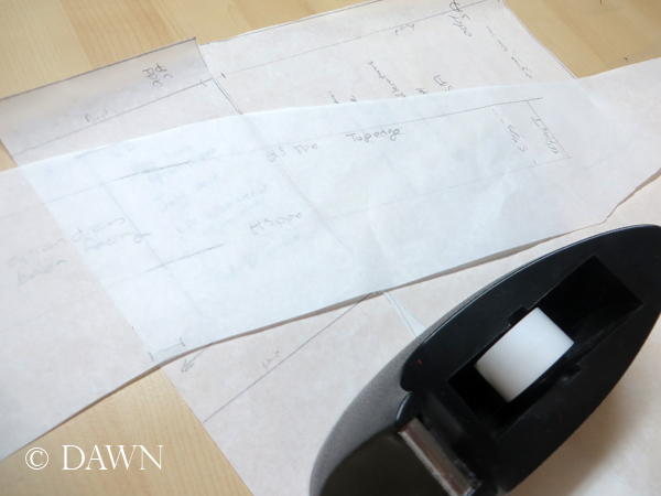 drafting the pattern for the (slightly shaped) reverse facing on the red linen  apron dress