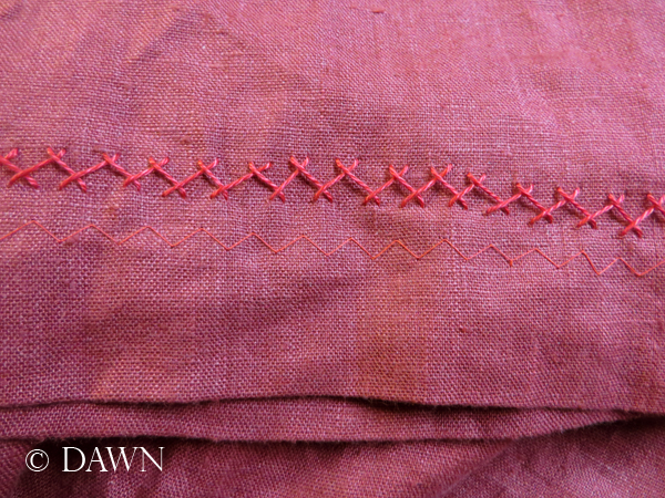 herringbone stitch on the hem of the red linen apron dress