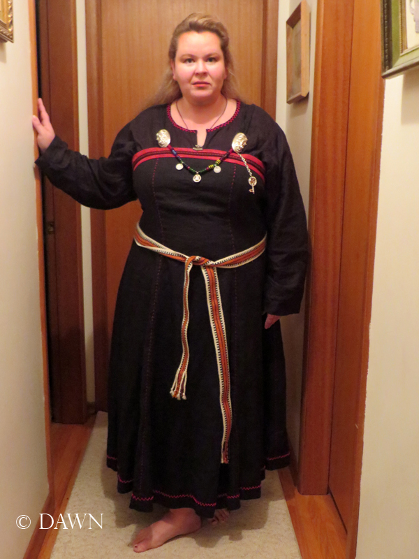 New black apron dress, worn with new brooches, a new key, and a new festoon.