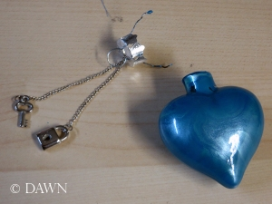 Attaching the charms to the heart-shaped ornament