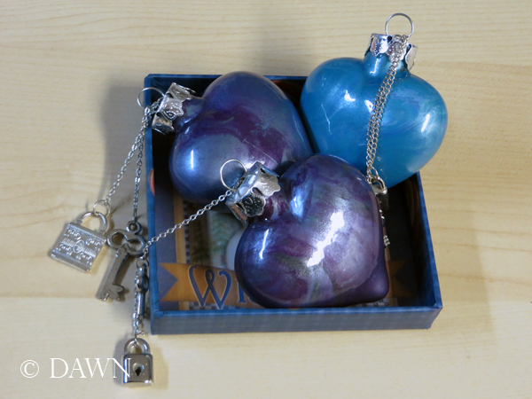 "Hand painted heart-shaped glass ornaments with ""lock and key"" charms"