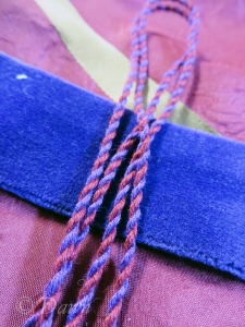 hand-made cord using purple and red embroidery floss
