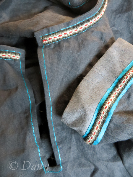 Focus on neckline and cuff of new blue linen underdress