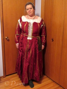 Full-length photo of the gown, taken late at night after the event