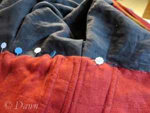 Slip-stitching the bodice lining to the skirt
