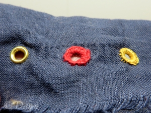 rom left to right - brass eyelet, DMC eyelet, brass eyelet covered in buttonhole twist (after lacing test)