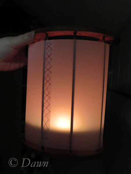 Lights off with a burning candle inside