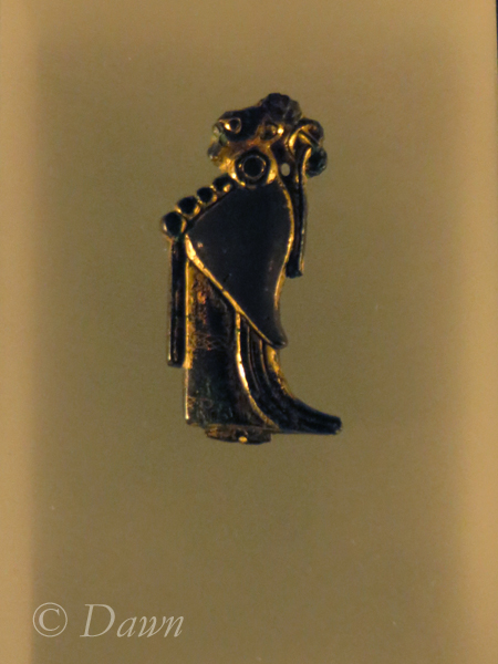 A pendant, associated with the Æsir, indicating believe that this is of, or associated with the goddess Frigg.